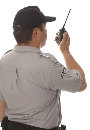 listening back: Security guard hand holding cb walkie-talkie radio