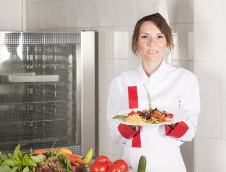 adult female chef in kitchen photo