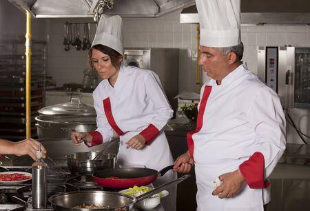 kitchen restaurant: Two chefs at work in a restaurant