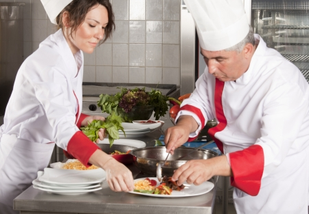 dinner wear: Two chefs at work in a restaurant