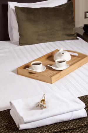 Tray with coffee on a bed in a hotel room