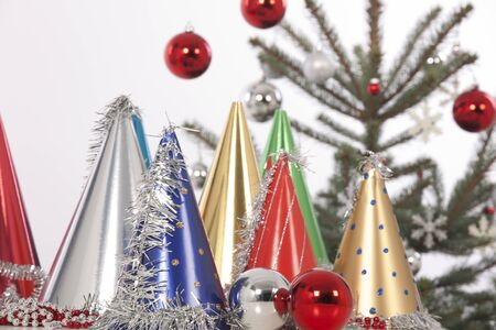 decorated christmas tree on white background with hats photo