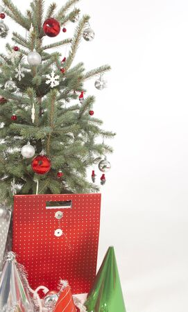 x mas: decorated christmas tree on white background with gifts