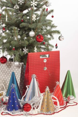 decorated christmas tree on white background with gifts photo