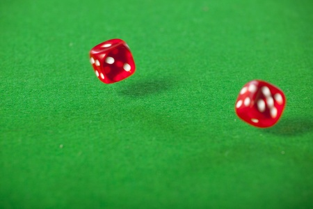 Rolling red dice on a casino table photo