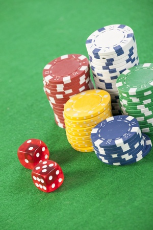 red dice on a casino table with chips  photo