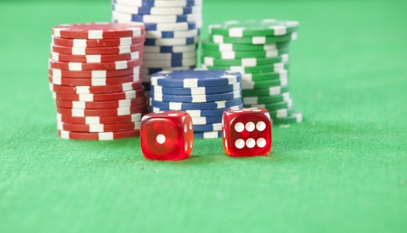 casino table: red dice on a casino table with chips
