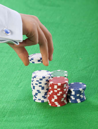 Hand using poker chips photo