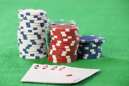 Cards and chips for poker on green table  photo