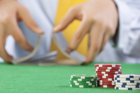 Two hands, shuffling a deck of cards of poker Stock Photo - 16894782