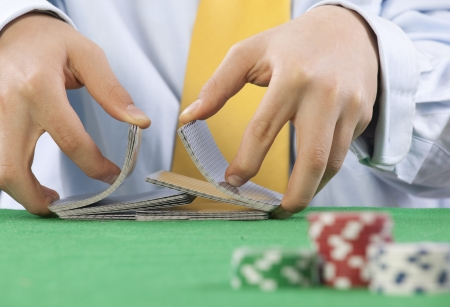 Two hands, shuffling a deck of cards of poker Stock Photo - 16894794