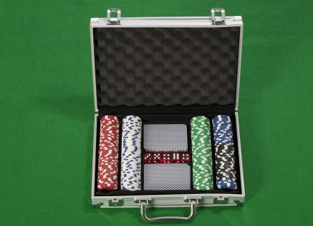 poker chips and cards in a briefcase Stock Photo - 17081381