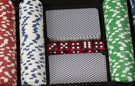poker chips and cards in a briefcase Stock Photo - 17081384