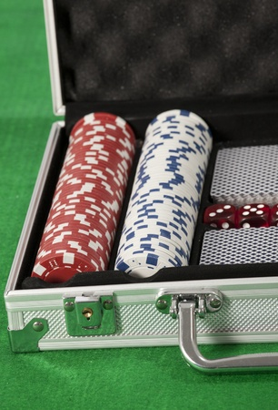poker chips and cards in a briefcase Stock Photo - 17081374