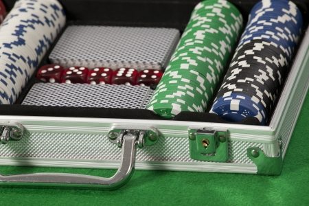 poker chips and cards in a briefcase