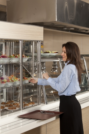 Business woman take cafeteria lunch self service buffet food  photo
