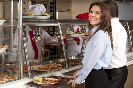 Business woman take cafeteria lunch self service buffet food