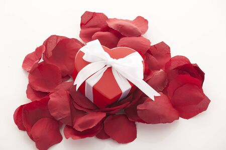 Valentines Day gift in red box with rose petal  photo