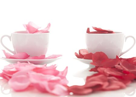 Coffee cup and rose petals  photo