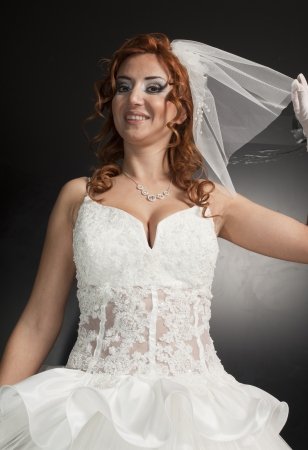 Beautiful bride against a black background photo