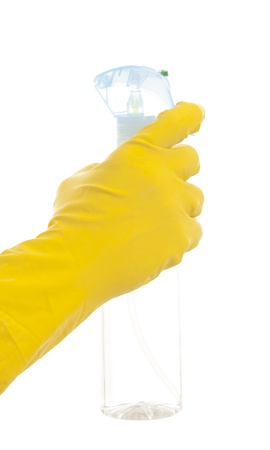 disinfecting: Hand in a yellow glove with cleaning spray  Isolated on white