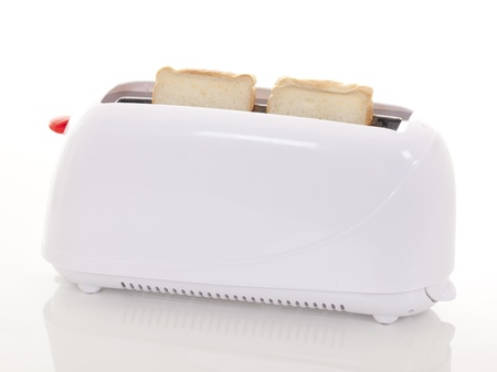 toaster:  toaster and two hot toasts ready to serve for the breakfast   Stock Photo