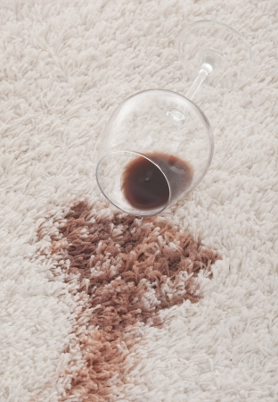 carpet stain: A glass of spilled wine on brand new carpet is sure to leave a stain