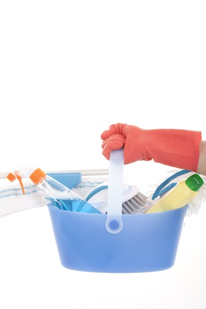Plastic bucket with cleaning supplies on white background  photo