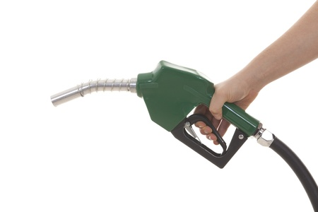 biodiesel: hand holding gas pump isolated on white Stock Photo