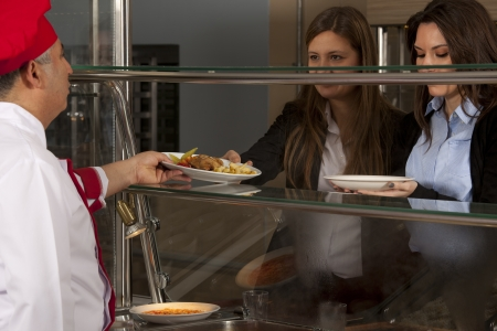 cafeteria tray: buffet self-service food display human hand take plate Stock Photo