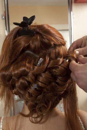 hair dresser: bride having hairdo on her wedding day