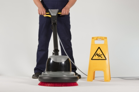 cleaning floor: cleaning floor with machine Stock Photo