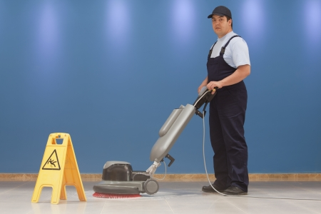 cleaning floor with machine photo
