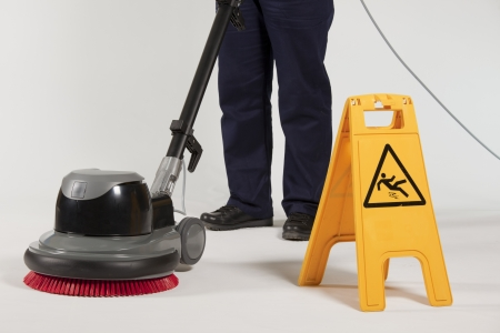 buffing: cleaning floor with machine Stock Photo