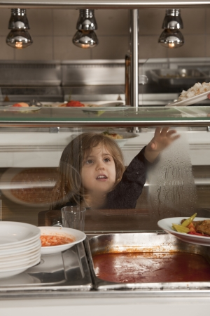 school cafeteria: little girl in school cafeteria waiting lunch
