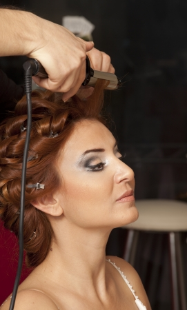 hair styling: Beautiful caucasian bride getting ready for the wedding ceremony.beautiful brunette young bride prepare for the event