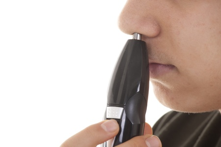 electric trimmer: Close up man portrait with trimmer near his nose