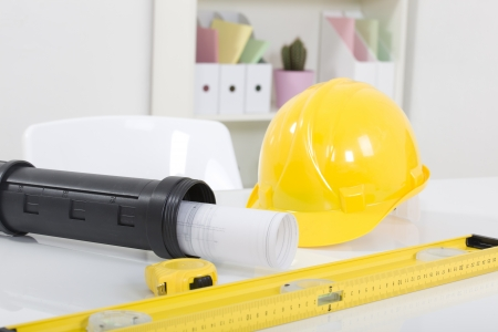 Hardhat  and measuring instruments on blueprint photo