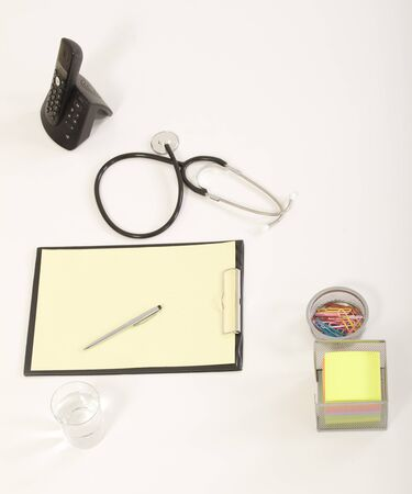 Medical Stethoscope with Pen on Medical File Folders Stock Photo - 19499408