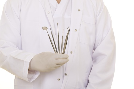 A dentists hands in white medical gloves with dental tools Stock Photo - 19656391