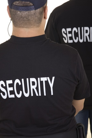 back of two security guards isolated on white