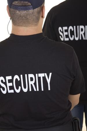 Rückseite von zwei Sicherheitsleuten isoliert auf weiß Lizenzfreie Bilder