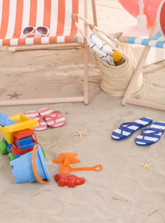 beach chair with colorful towel and toys photo