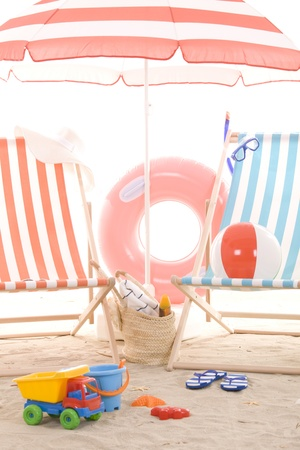 beach toys: beach chair with colorful towel and toys Stock Photo