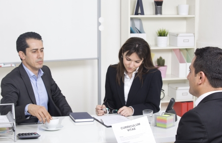 man explaining about her profile to business managers at a job interview Standard-Bild