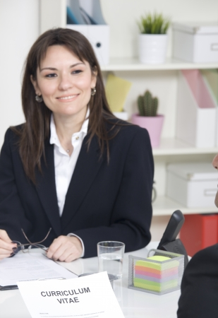 querying: Woman in Job interview Stock Photo