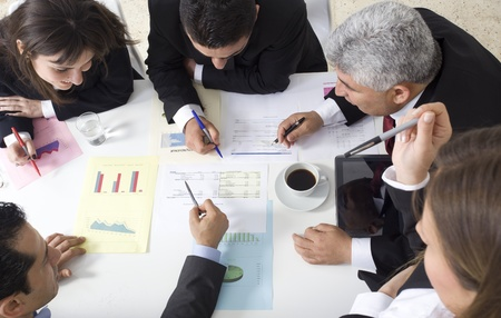 casual meeting: Businesspeople working together at meeting, discussing document Stock Photo