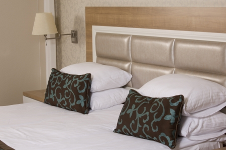 luxury hotel room: King sized bed in a luxury hotel room