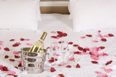 romantic room: wine in bed to celebrate Valentines Day at hotel room