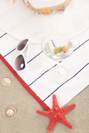 beach items on sand for fun summer holiday photo